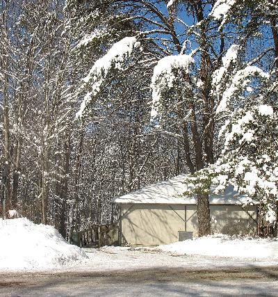 View from the road - Back of cabin on a snowy day