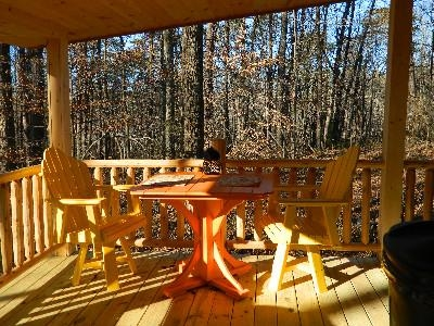 The Landing - Table and chairs on the deck featuring a fantastic view of the forest.