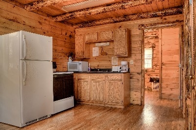 Chestnut Grove Cabin3 Kitchen - Chestnut Grove Cabin 3 Kitchen has all full-size appliances such as refrigerator, stove, microwave, toaster and coffee pot. The comforts of home in the middle of the woods.