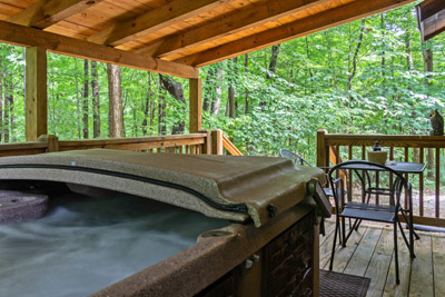 Back covered porch - Our hot tub is located on the back door on our covered porch