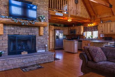 The Great Room - The heart of the cabin, the great room. It features our seasonal gas fireplace and flat screen tv. We have 3 couches for your seating area.