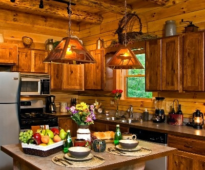 Photo 1412_2732.jpg - Prepare your dinner in our fully stocked hickory kitchen with stone breakfast bar