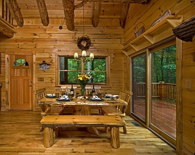 Photo 1412_2736.jpg - Our rustic tree stump table is a one of a kind dining experience!