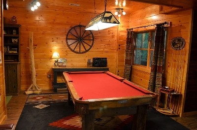 Photo 1412_4032.jpg - Three full floors to explore and enjoy at our luxury log cabin!  Brand new custom made Barn Wood Pool Table with rustic log bar and HDTV just around the corner!  Second bathroom, Sauna, and stove fireplace on this level as well - along with a variety of games and movies.