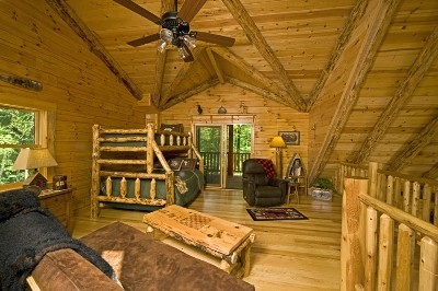 Photo 1412_4169.jpg - The loft has it all... sleep, relax, read, or watch your favorite show! Private balcony too!