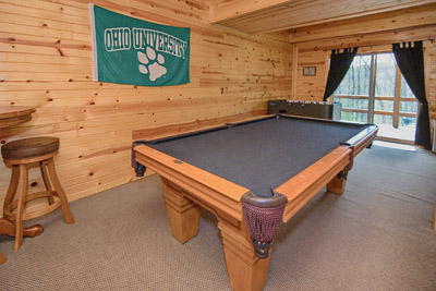 Bobcat Bluff Game Room - Basement rec room features a walk out to the lower deck, pool table, foosball, media area with TV and DVD player
