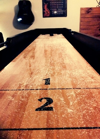 Shuffle Board - Our Awesome Shuffle Board table is just another part of The Grand Tara Lodge extensive Entertainment you wont find anywhere else