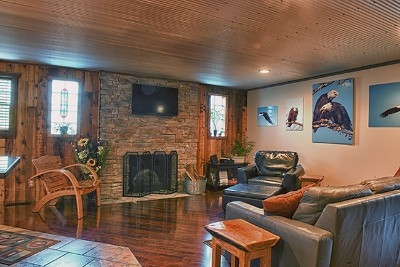 Living room - Cherry floors, stone fireplace, leather furniture and lots of details for you to enjoy during your stay.