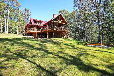 Rear Exterior View with Fire Pit - Private setting with nothing but woods surrounding the Lodge.  Fire pit for s