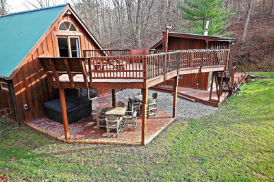 Exterior Decking - View of multiple decks and patio with hot tub.