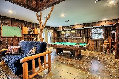 Game Room - Features Pool table, dart board, pub table and flat screen tv with blue tooth soundbar.