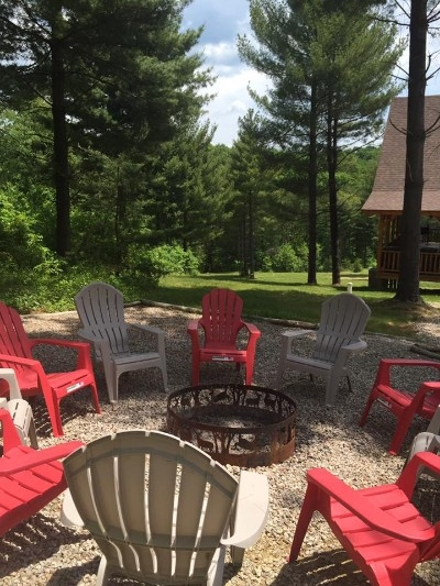 Fire Pit - Outdoor gravel fire pit just off of the parking area. Adirondack chairs and a fire ring. We provide 3 bundles of wood for each stay.