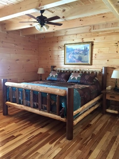 Main Level Master Bedroom - King-sized pillow-top mattress on handmade cedar/walnut beds. Linens are always included with your stay.