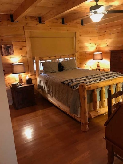 Main Level Master Queen Bedroom - Queen-sized bed and private en-suite bathroom.