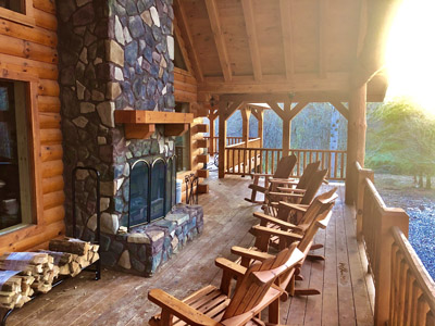 Outdoor Fireplace - Hours of enjoyment rocking and relaxing right by our indoor/outdoor fireplace.