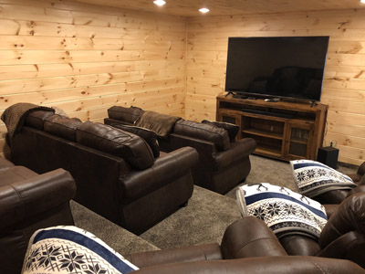 Dogwood Manor Theatre - Seating for 12, surround sound speakers, blu-ray player and plenty of complimentary dvds.