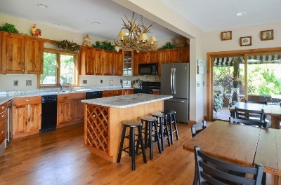Kitchen area - The kitchen is large enough for you to feed your large group.  Seating for 32 in the dining room.