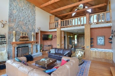 Great Room - Plenty of seating, fireplace, TV and floor to ceiling windows with a spectacular view.