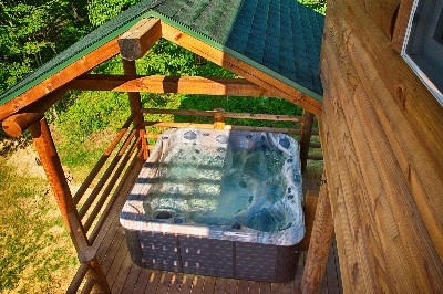 Hot Tub from the Master Bedroom Deck - Multiple porches layer the outside of the cabin.