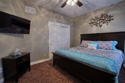 King Bedroom - 1 of 6 Bedrooms with Kin Beds and TV