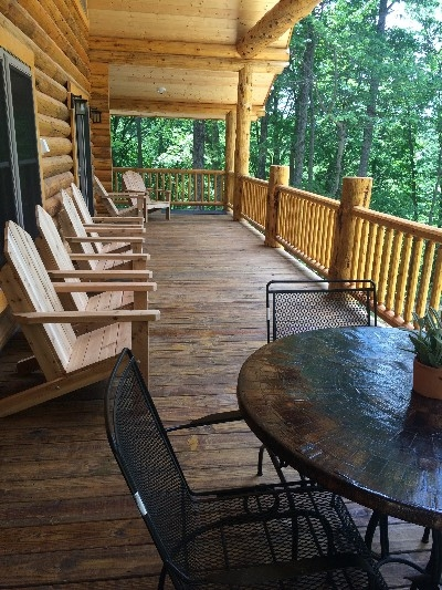 Upper Porch - Each adirondack chair was custom built by a local craftsman.  The upper porch also has a gas grill, and propane is included for all guests.