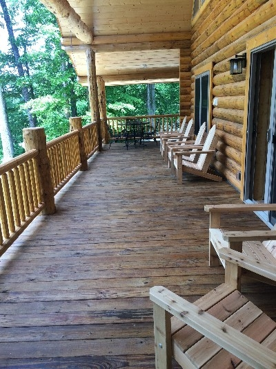 Upper Porch - Over 900 sq. ft. of covered porch overlooking a scenic ridge provides ample space for guests to kick back, relax and soak in the beautiful outdoors.
