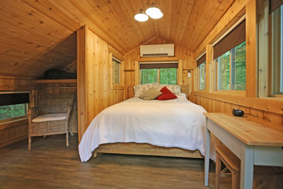 White Oak Treehouse Master - The master bedroom in The White Oak Treehouse has lots of window to let you enjoy the views from all sides  Hocking Hills Treehouse Cabins