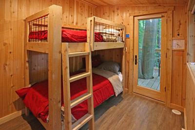 Hidden Bunk Room at White Oak Treehouse - The bunk bedroom at White Oak Treehouse is accessed via a hidden door - just like something out of Harry Potter!  Hocking Hills Treehouse Cabins