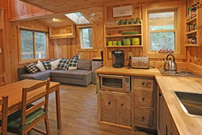 Maple Kitchen  Living Room - Our treehouse accommodations include a kitchenette with toaster, toaster oven, electric cooktop, Keurig, crockpot, and electric griddle  Hocking Hills Treehouse Cabins