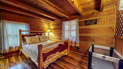 Lonesome Holler Private Bedroom 2 - Main Floor Private queen log bedroom with pack and play