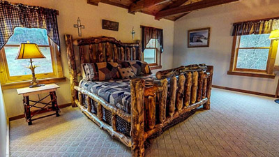 Lonesome Holler King Log Bed - Custom Made King Log Bed located in the loft area