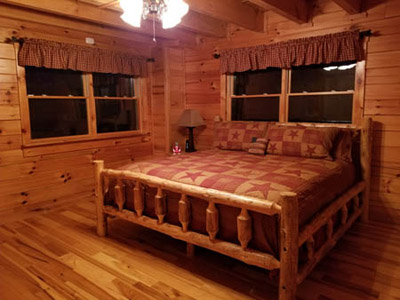 Honeysuckle Ridge King Log Bed - Main floor Private King Log Bedroom