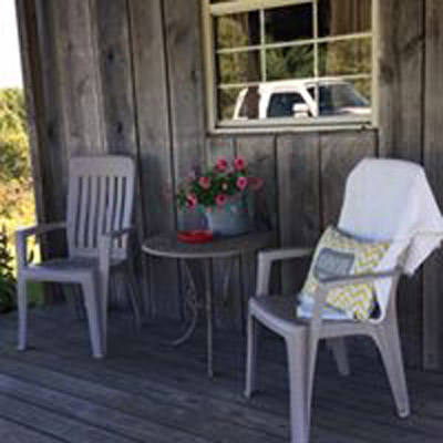 White Pine Cabin front porch  - Front porch, perfect place to sit  enjoy the view or listen to the rain on the tin roof