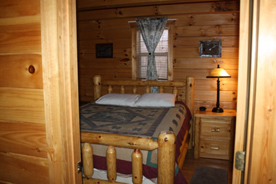 Lazy Den - Downstairs bedroom Queen size log bed
