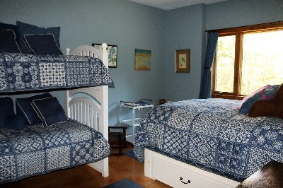 Lovely Bedroom - This bedroom is so inviting.  It sleeps 2 in queen bed.  The two twins aid two more guests.