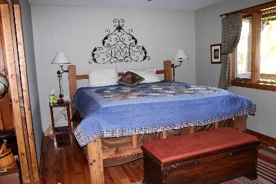 Heartland Lodge Master Suite - This King bed with private bath, siting area, and large screen TV are wonderful features to enjoy