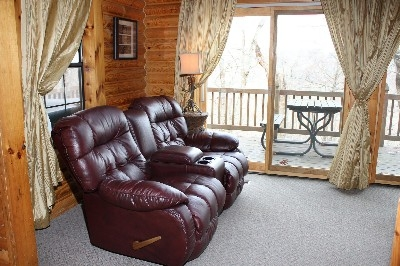 Living Room - Enjoy the wood burning fireplace or DirecTV from your couch.