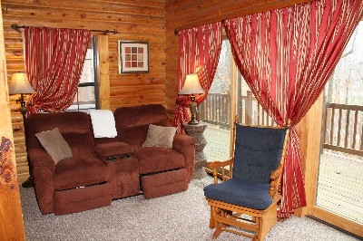 Living Room- Van Buren 1 - Relax and enjoy the wood burning fireplace from the comfy couch.