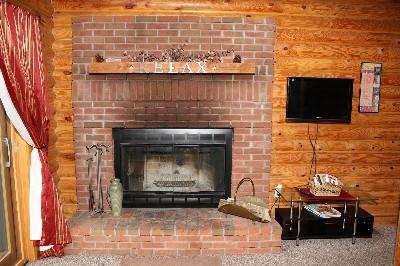 Wood-burning Fireplace - Enjoy the wood-burning fireplace or movies on the TV.