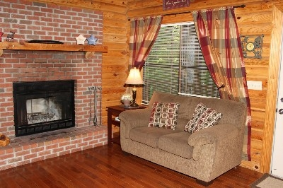 Fireplace - Living room includes a wood burning fireplace.