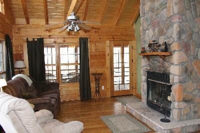 Living Room - Living room includes wood burning fireplace.