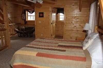 Loft Bedroom - Loft bedroom includes queen bed and half bath.