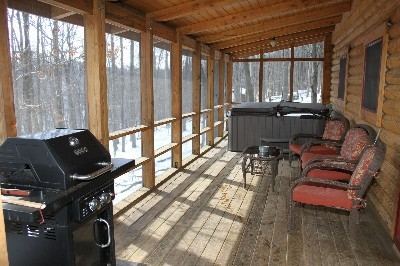 Hot Tub - Hot tub is located on a covered, screened in porch!
