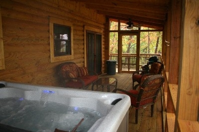 Hot Tub - Hot tub is located on a covered, screened in porch.