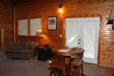 Living Room - Living room includes a sectional, over-sized chair, high top table and wood burning stove.