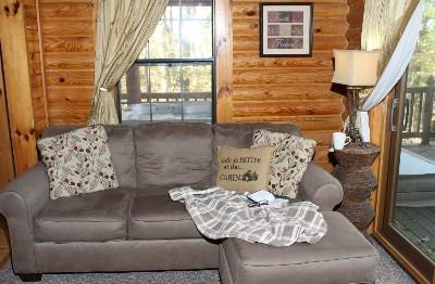 Living Room- Van Buren 1 - Full Living room with wood-burning fireplace.