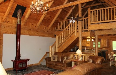 Sunrise Retreat Living Room  - Full living room, and wood burning stove.