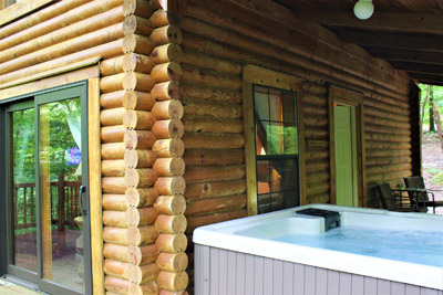 Hot Tub  - Hot tub on covered porch.