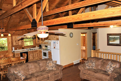 Upstairs - Full kitchen, living room, two beds with queen beds upstairs and a bathroom.