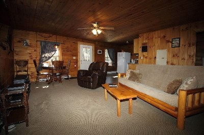 Living Room at Tall Pines - Large living room with fire place, Direct TV, Bluray, comfy leather recliner
